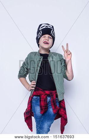 Fashionable little bad boy. Studio portrait isolated over white background