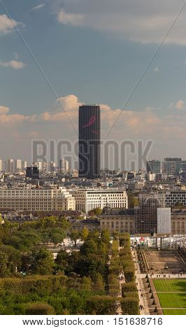 Paris France-October 09 2016: The Montparnasse tower sporting a giant 43 meters pink ribbon on its facade as part of the Global Breast Cancer Awareness Month Campaign.