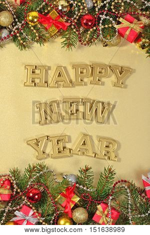 Happy New Year Golden Text And Spruce Branch And Christmas Decorations