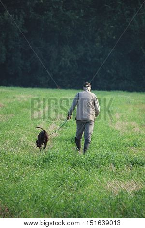 Hunter with his German Shorthaired Pointer hunting dog