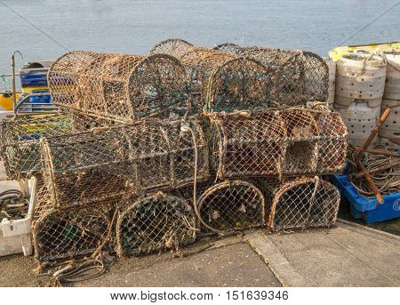 Old Lobster pots stacked on the quayside