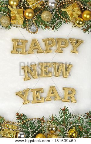 Happy New Year Golden Text And Spruce Branch And Christmas Decorations On A White