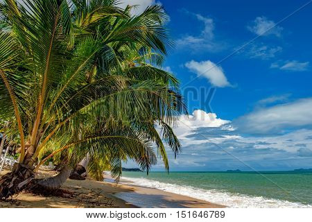 Sunny day with blue cloudy sky at tropical Maenam beach Koh Samui Thailand