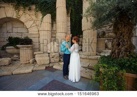 wedding copule. Beautiful bride and groom. Just merried. Close up. Happy bride and groom on their wedding hugging.