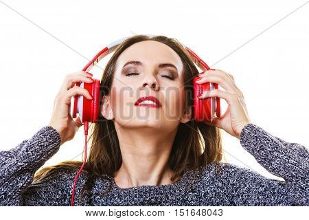 People leisure relax concept. Woman casual style red big headphones listening music mp3 relaxing
