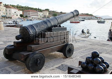 Senj Croatia - September 16 2016: a small town in northern Croatia located on the Adriatic coast. The oldest parts of buildings in the old town come from the fifteenth century. On the picture replica of old cannon standing in the port.