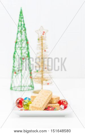 Fresh buttery shortbread cookies in a festive christmas setting.