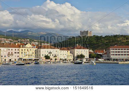Senj Croatia - September 16 2016: a small town in northern Croatia located on the Adriatic coast. The oldest parts of buildings in the old town come from the fifteenth century. On the picture is the harbor, the boats, in the background you can see the old