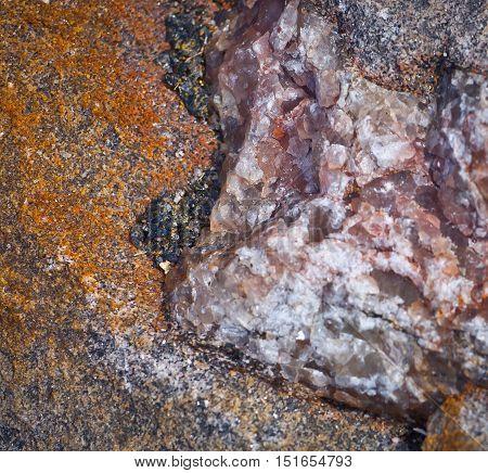 Pink, white, orange and black quartz vein