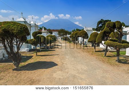 San Lazaro Cemetery Antigua Guatemala - May 6 2012: View through cemetery with Agua volcano behind in Spanish colonial town of Antigua