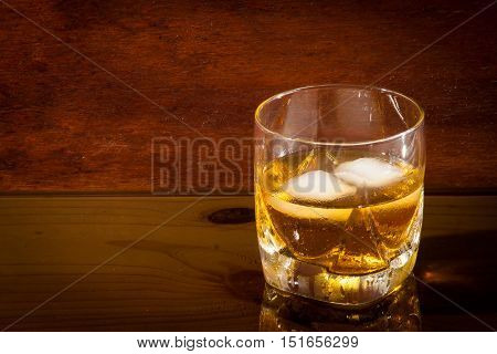 glass of whiskey shot on a glass table