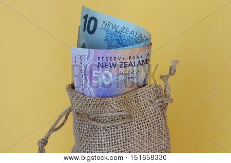 NZ money in a brown hessian sack.