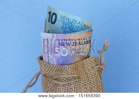 New Zealand money in a hessian sack.