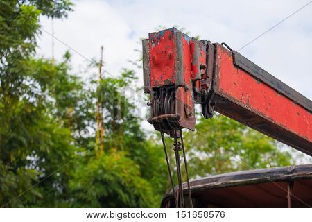 Red truck crane close up. Transportation and technology concept.