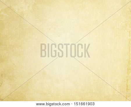 Aged yellowed paper background for the design. Grunge paper texture.