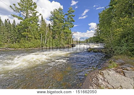 Rushing falls in the North Woods of the Falls Chain in Quetico Provincial Park in Ontario