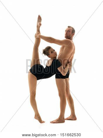 Dance partners posing at camera. Isolated on white backdrop