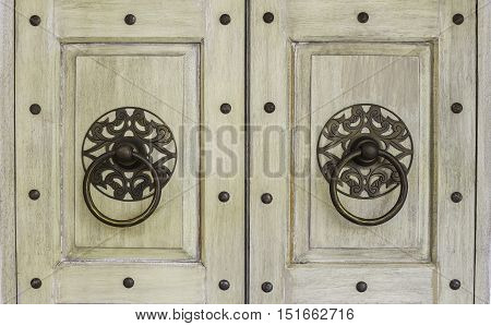 Hang door knocker metal on wooden background