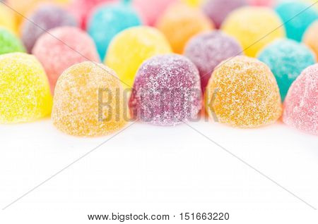 Colorful fruit jelly with sugar-coated on white background