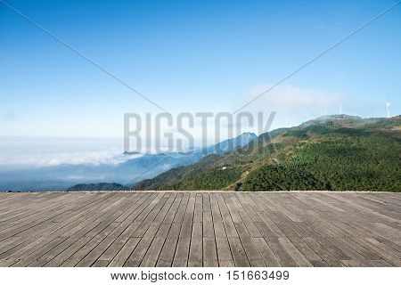 sea of clouds and wind farm on the jiugong mountain with wooden floor prospects hubei provinceChina