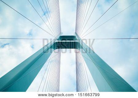 blue cable stayed bridge closeup upward view