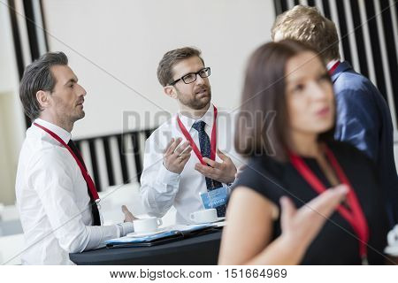 Business people talking during coffee break at convention center