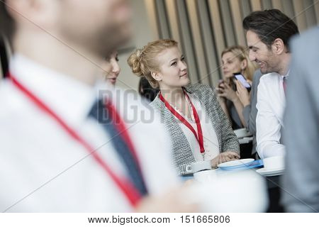 Business people talking at lobby in convention center