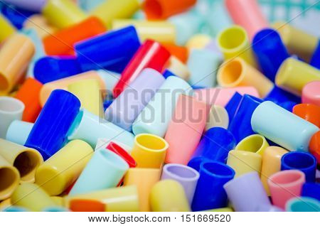 Outfocus Of Cork Tube(plastic) Is Colorfull For Use Backgroud ,texture And Wallpaper.
