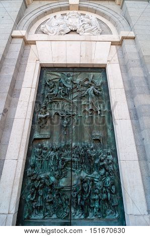Ornate Bronze Door Of The Almudena Cathedral In Madrid, Spain.