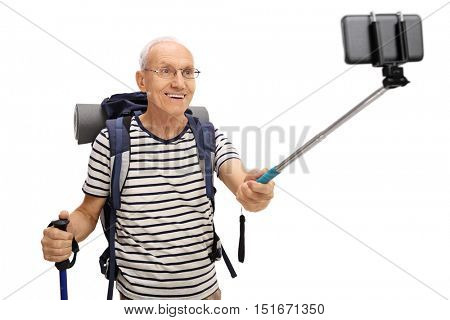 Senior hiker taking a selfie with a stick isolated on white background