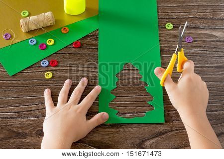 The Child Create Christmas Greeting Cards Paper Festive Fir. The Child Cut Out Paper Details. Childr