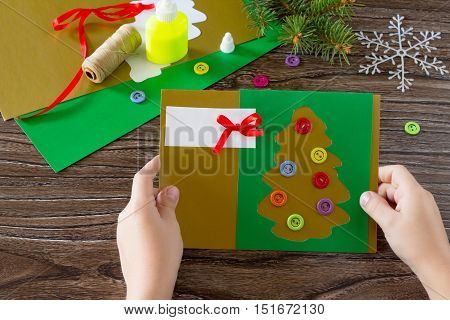 The Child Create Christmas Greeting Cards Paper Festive Fir In Christmas Tree Toys. Glue, Scissors,