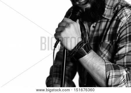 Microphone isolated in singing man hand concept pop music
