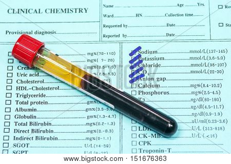 Blood In Test Tubes And Investigation Form In Laboratory.