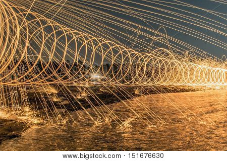 The Work Of Glowing Sparks From Spinning Steel Wool By Human.