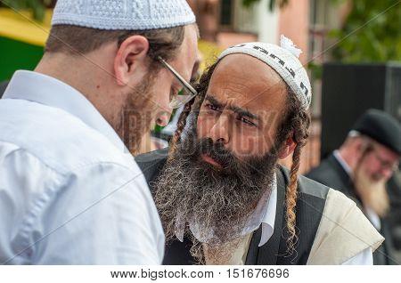 Conversation between two Hasidic. Uman, Ukraine - 2 October 2016.