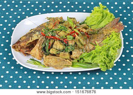 Green tilapia fish curry in coconut milk is popular Thai cuisine .