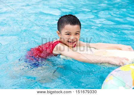 Happy Asian Chinese Little Boy Swimming With Floating Board