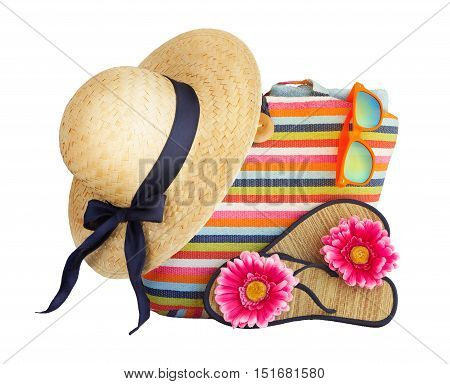 Beach bag, hat and other beach stuff isolated on white background.