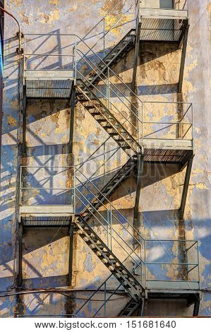 old metal fire escape on the wall of the pre-war factory in Lodz