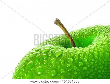 Green wet apple isolated on white.