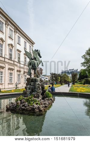 Salzburg Austria - April 29 2015: Horse statue and fountain in Mirabell Gardens. Salzburg is renowned for its baroque architecture and was the birthplace of Mozart. It is an Unesco World Heritage Site.