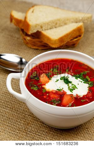 Traditional Ukrainian borsch with sour cream meat garlic and parsley