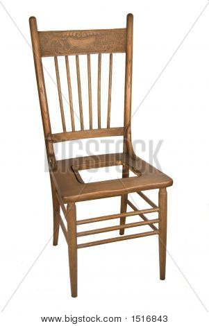 antique carved back wooden kitchen chair stock photo