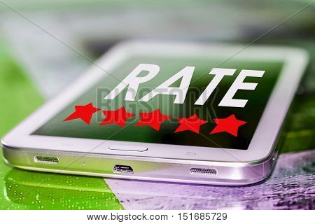Smartphone with 5 stars and rate button on phone screen.