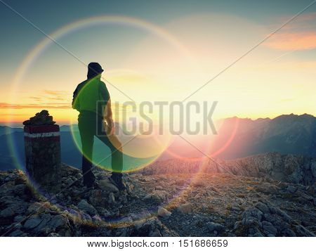 Lens Flare Light. Bow Light Circles. Tourist At Border Stone On Alpine Mountain