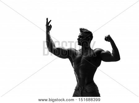 The beautiful and strong young guy.  Black and white photo, silhouette