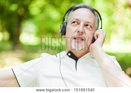 Man listening music in a park