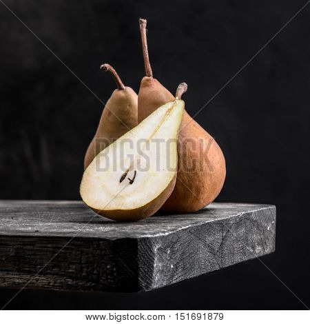 pear on a wooden board