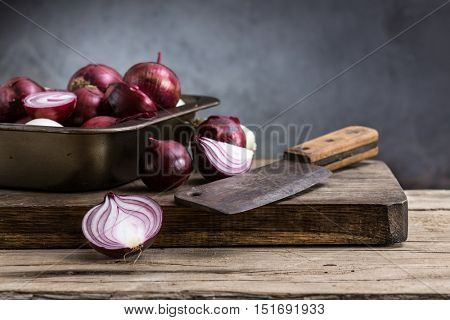 red onion on a wooden board. still life